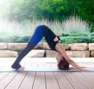 Downward Facing Dog pose to energize and wake you up during your morning yoga sequence